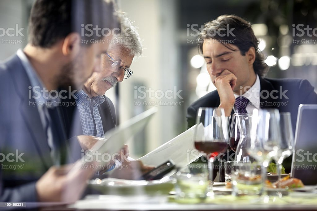 Businesspeople having meeting in the restaurant stock photo