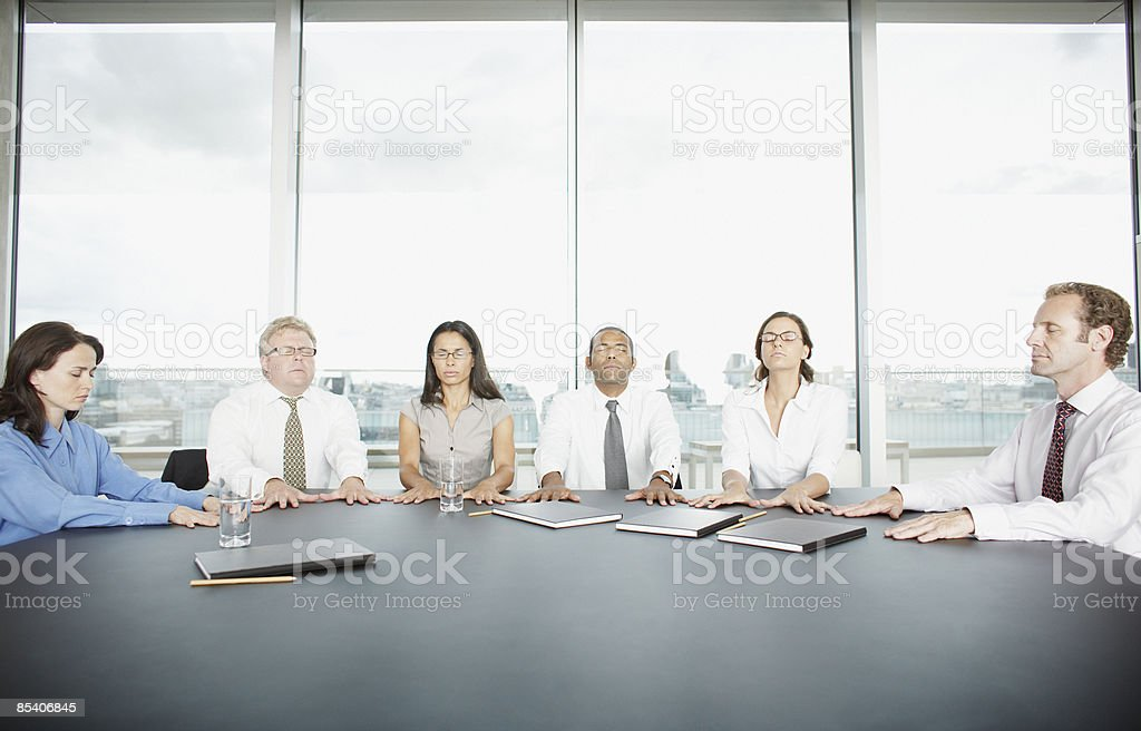 Businesspeople having seance at conference table 免版稅 stock photo