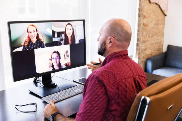 Businesspeople hold virtual meeting during COVID-19 pandemic stock photo