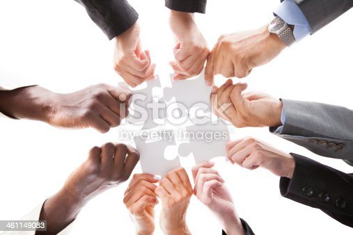 istock Businesspeople Holding Jigsaw Puzzle 461149083