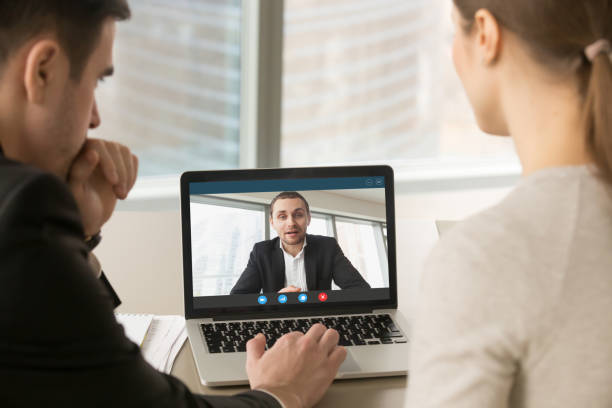 Businesspeople holding online meeting on laptop, making video ca stock photo