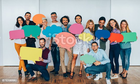 istock Businesspeople holding speech bubbles 875398880