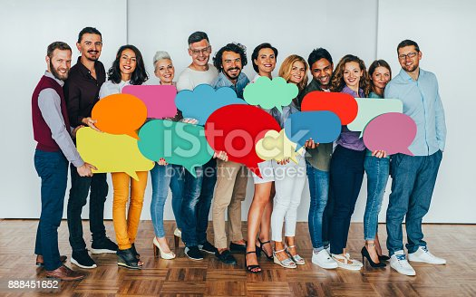 istock Businesspeople holding speech bubbles 888451652