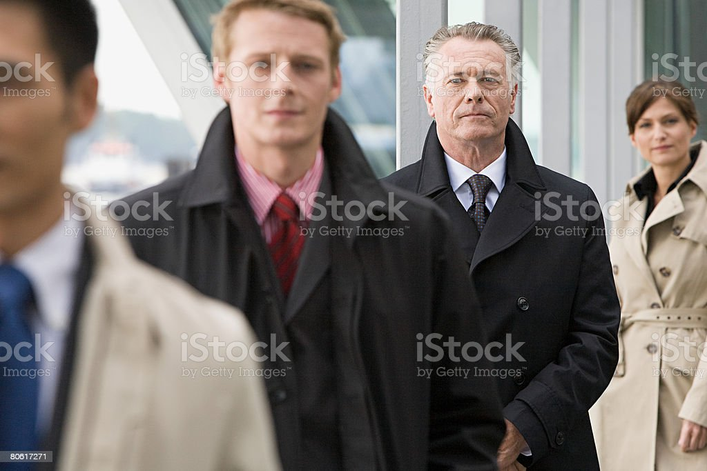 Businesspeople in a row royalty-free stock photo