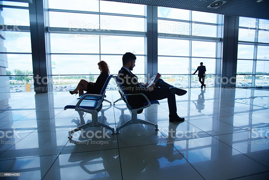 Businesspeople in airport stock photo