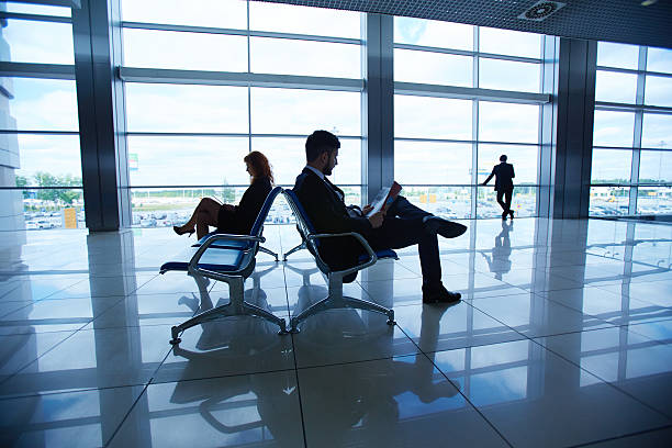 businesspeople in airport - leaving partnership corporate business sitting stock photos and pictures