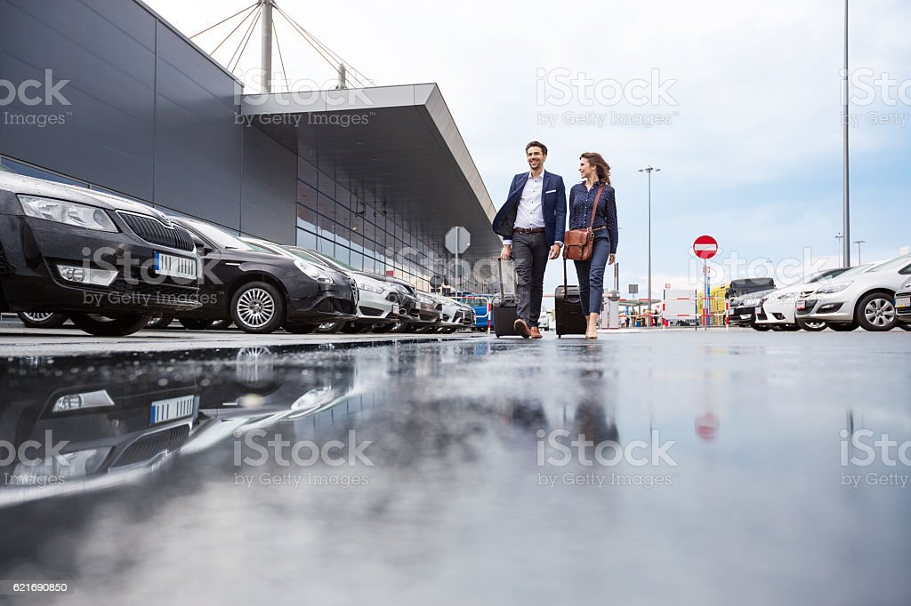 Businesspeople in an airport car parking stock photo