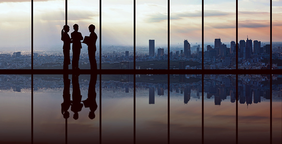 Businesspeople in front of urban cityscape.