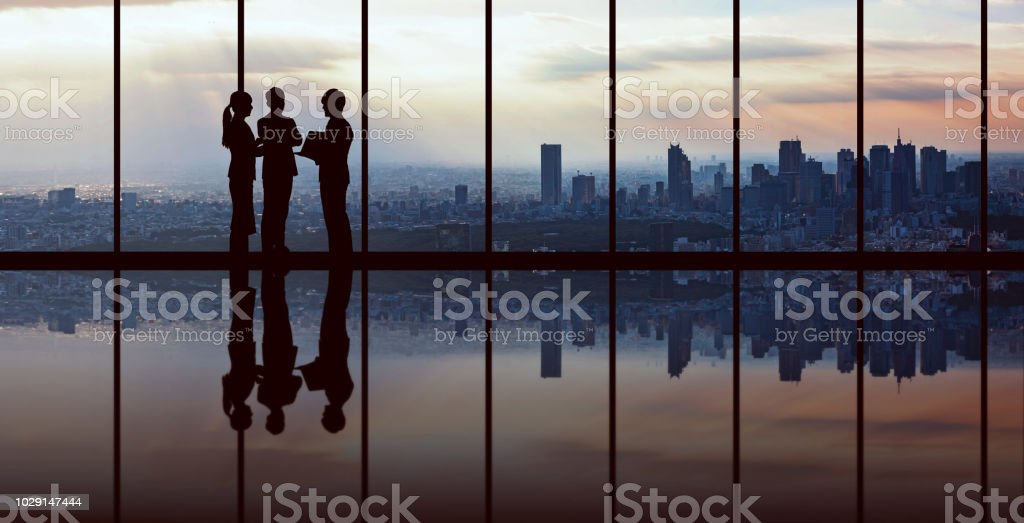 Businesspeople in front of urban cityscape. stock photo