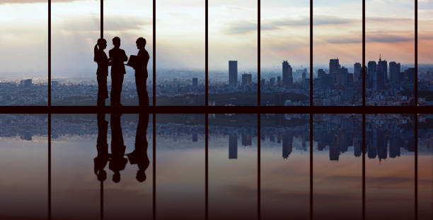 businesspeople in front of urban cityscape. - business meeting stock pictures, royalty-free photos & images