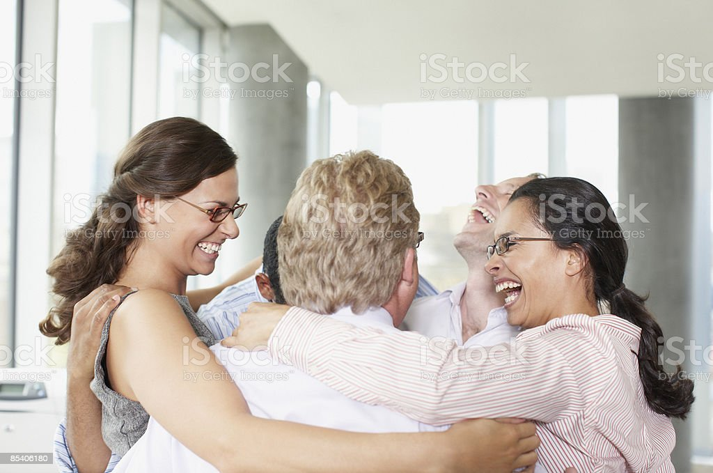 Businesspeople in huddle in office royalty-free stock photo