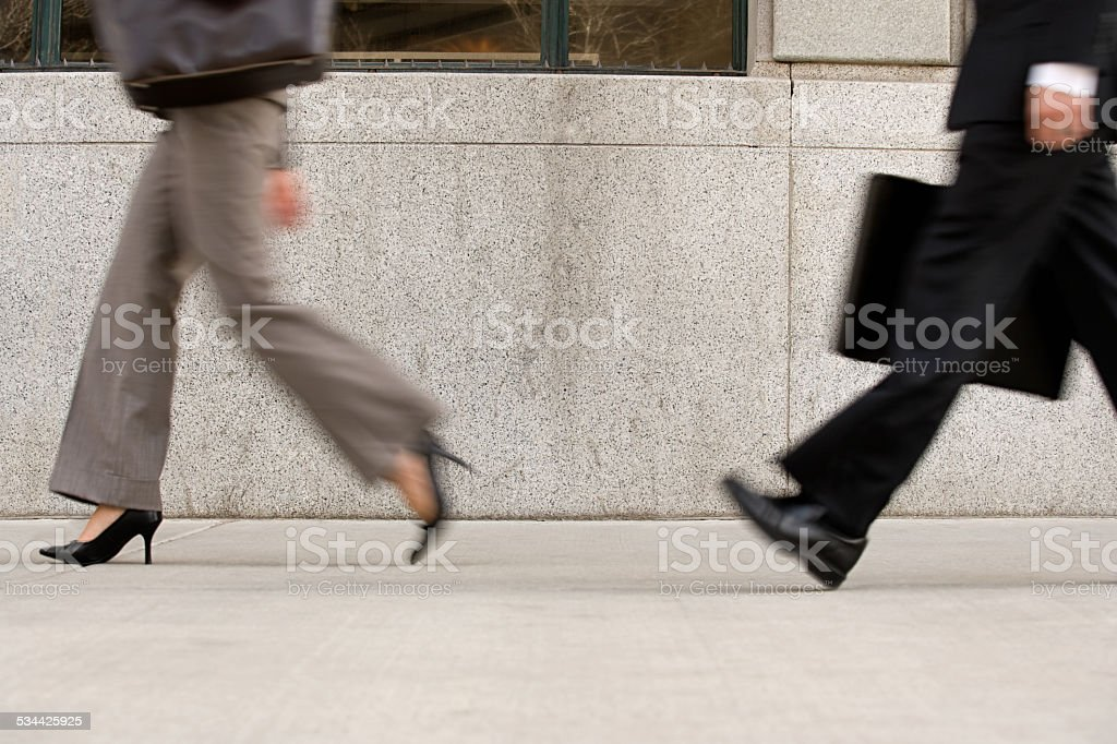 Businesspeople in hurry stock photo