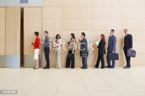 84743203 istock photo Businesspeople in line up 74181261