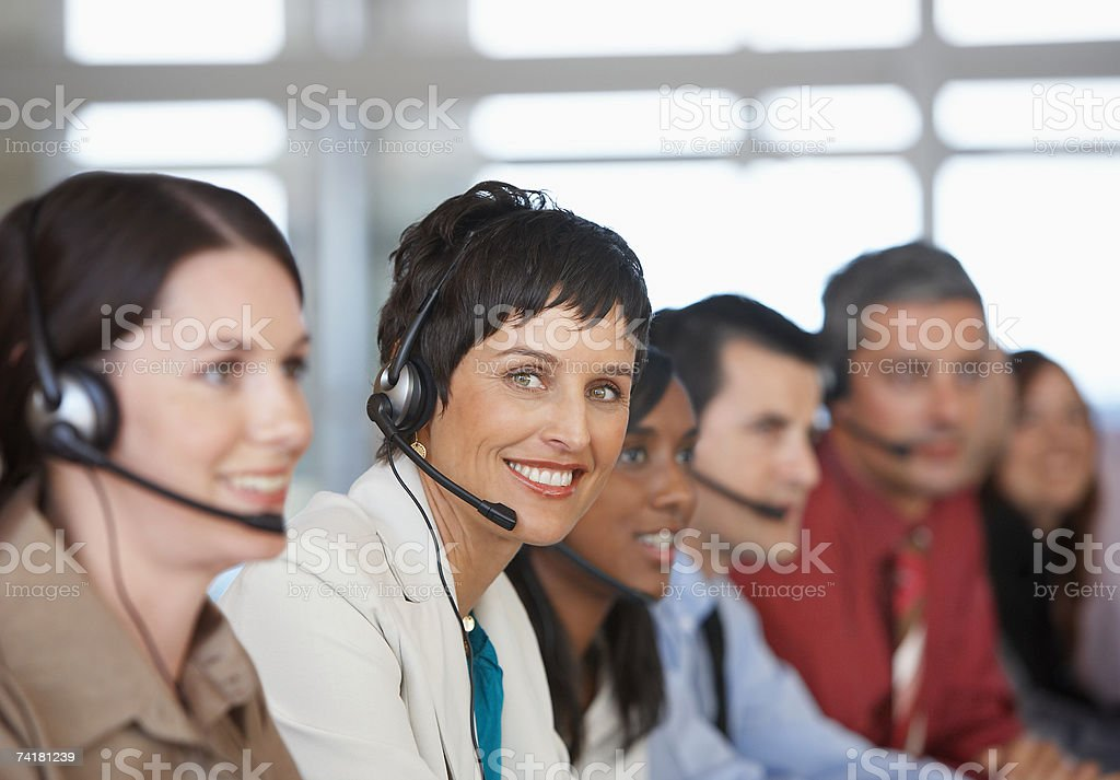 Businesspeople in meeting with translation stock photo