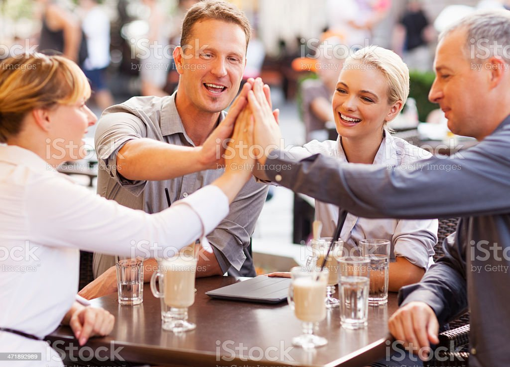 Businesspeople joining hands royalty-free stock photo