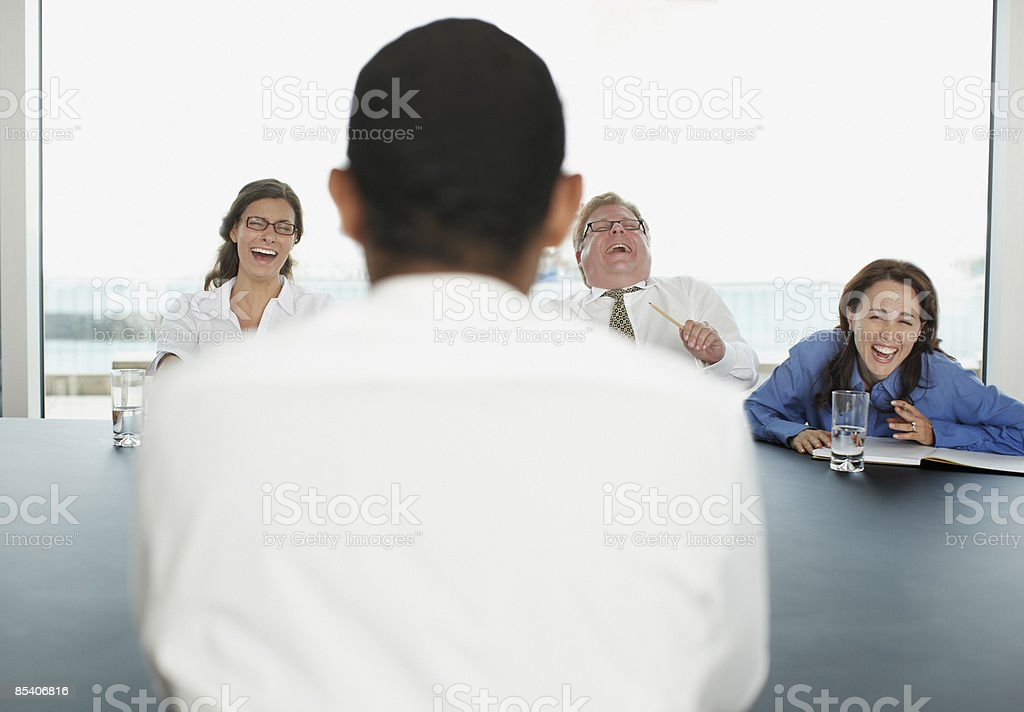 Businesspeople laughing during meeting in conference room royalty-free stock photo