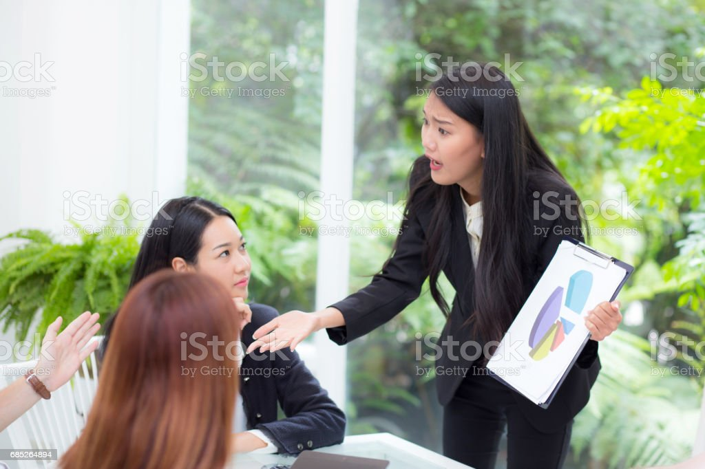 businesspeople looking at businesswoman opinion different his colleague in meeting. royalty-free stock photo