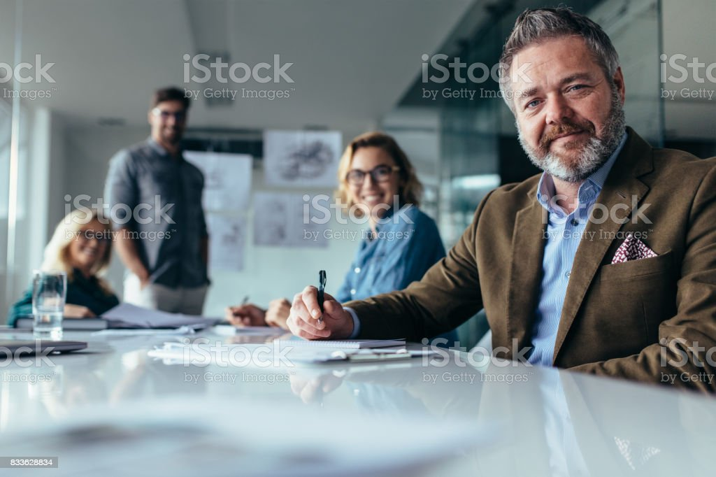 Businesspeople looking at camera with smile stock photo
