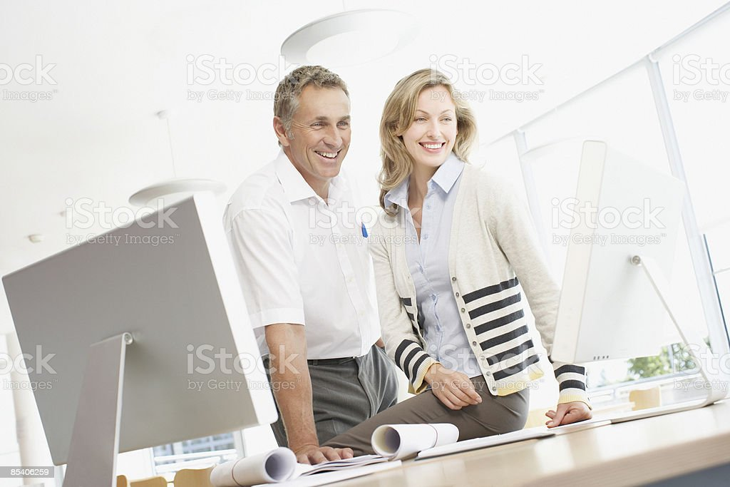 Businesspeople looking at computer monitor royalty-free stock photo