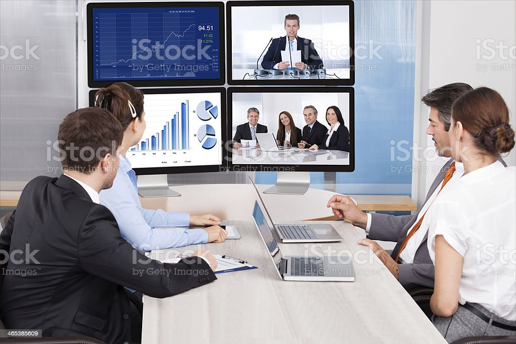 Businesspeople Looking At Computer Screen stock photo