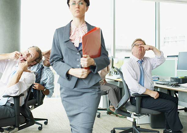 businesspeople making face at boss in office - arrogance stock pictures, royalty-free photos & images