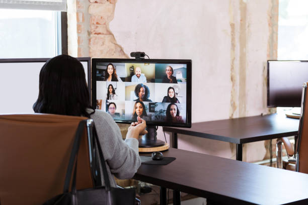 Businesspeople meet virtually during COVID-19 pandemic stock photo