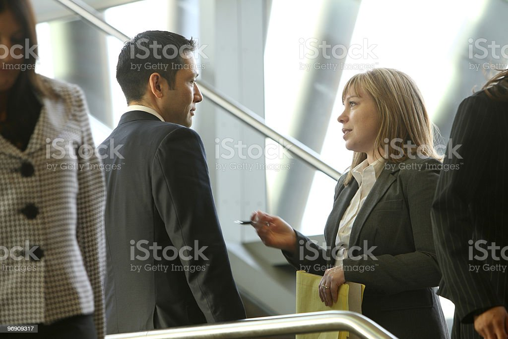 Businesspeople meeting on steps royalty-free stock photo
