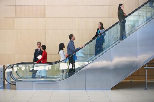 Businesspeople on escalator