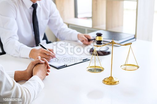 941906652 istock photo Businesspeople or lawyer having team meeting discussing agreement contract documents, judge gavel with Justice lawyers at law firm in background, Legal law, advice and justice concept 1033605254