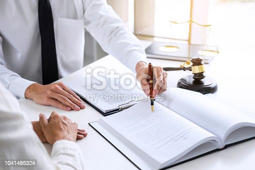 941906652 istock photo Businesspeople or lawyer having team meeting discussing agreement contract documents, judge gavel with Justice lawyers at law firm in background, Legal law, advice and justice concept 1041485324