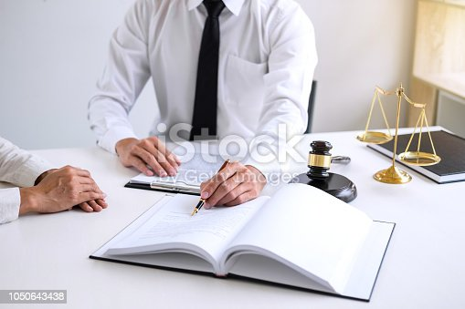 941906652istockphoto Businesspeople or lawyer having team meeting discussing agreement contract documents, judge gavel with Justice lawyers at law firm in background, Legal law, advice and justice concept 1050643438