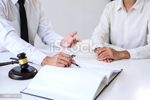 941906652 istock photo Businesspeople or lawyer having team meeting discussing agreement contract documents, judge gavel with Justice lawyers at law firm in background, Legal law, advice and justice concept 1066273220
