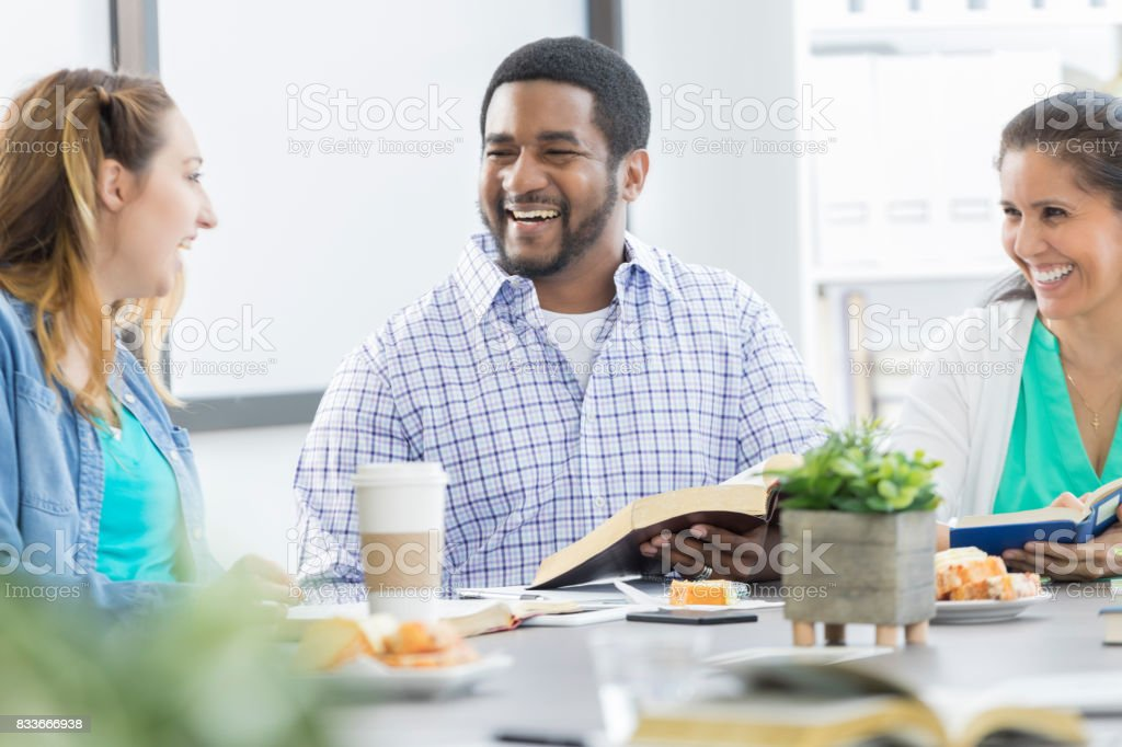 Businesspeople participate in Bible story during lunch stock photo
