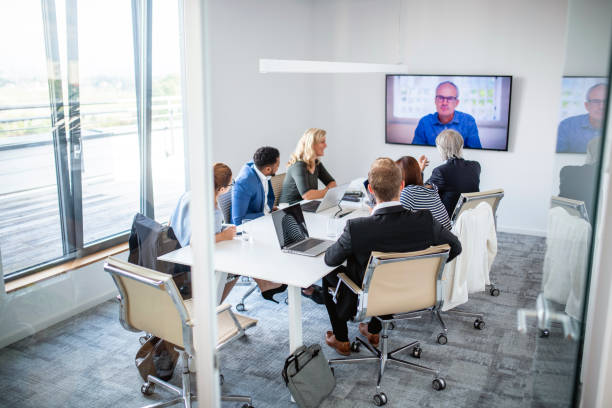 Businesspeople Participating in Video Conference stock photo