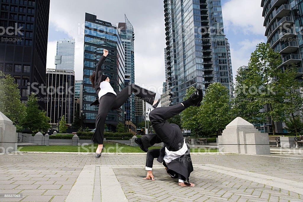 Businesspeople practising capoeira stock photo