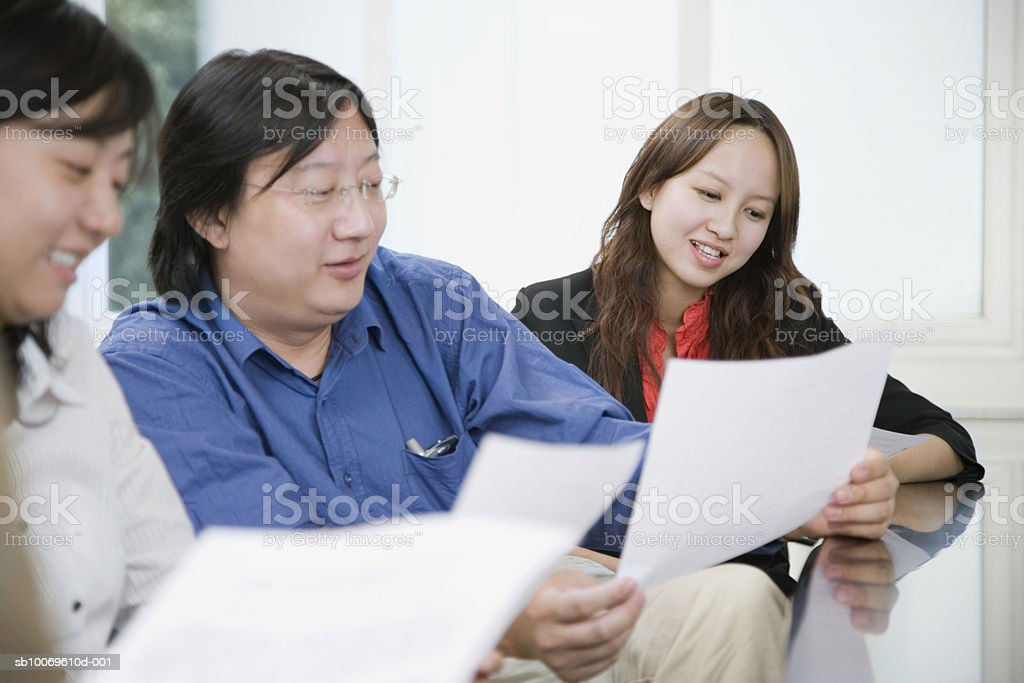 Businesspeople reading documents in conference room royalty-free stock photo