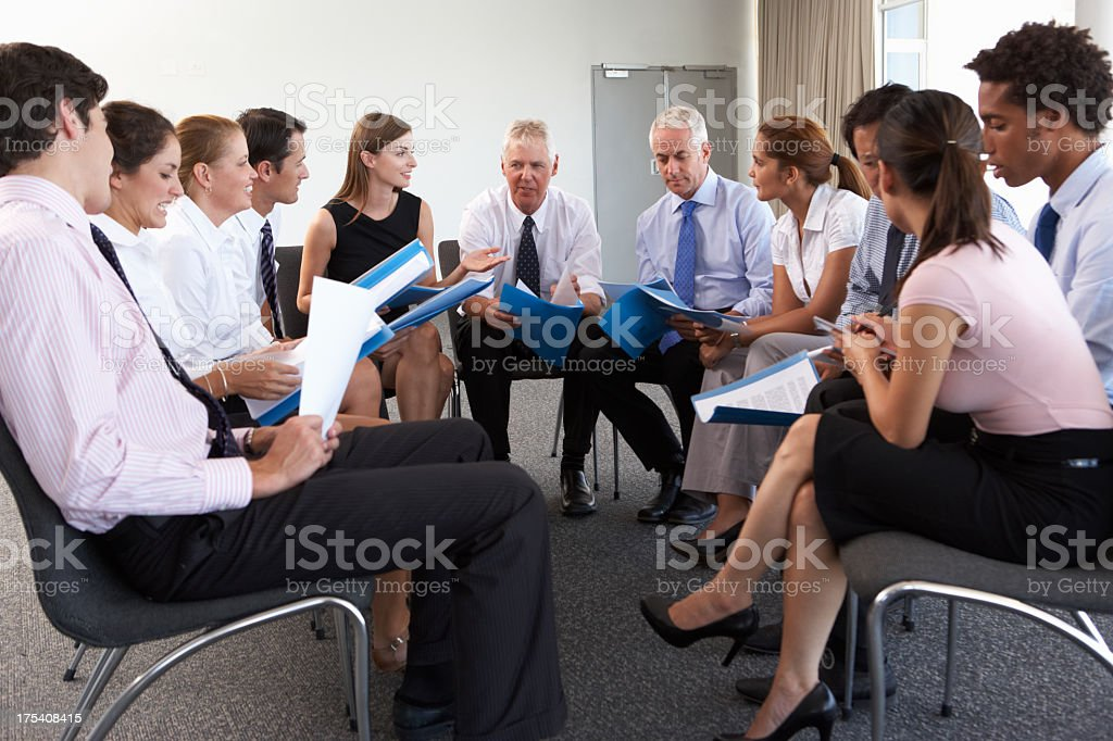 Businesspeople Seated In Circle stock photo