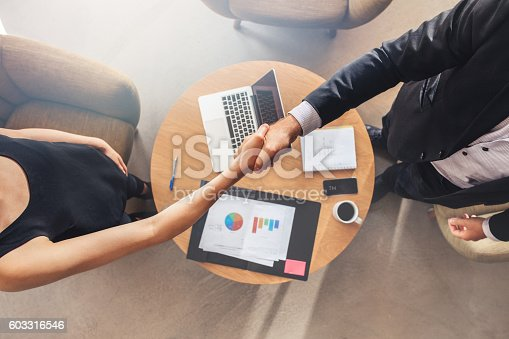 istock Businesspeople shaking hands after a successful meeting 603316546