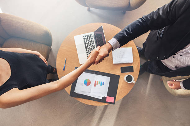 businesspeople shaking hands after a successful meeting - jacob ammentorp lund stock pictures, royalty-free photos & images