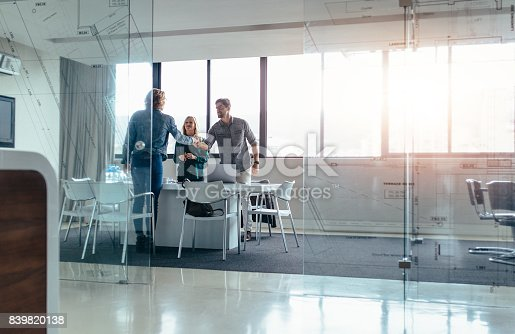 istock Businesspeople shaking hands after successful meeting 839820138