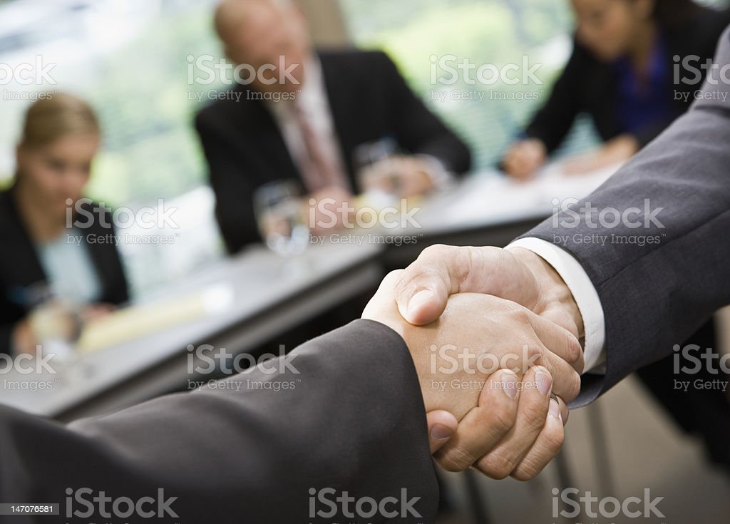 Businesspeople Shaking Hands During Meeting royalty-free stock photo