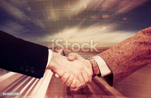 istock Businesspeople shaking hands 944655286