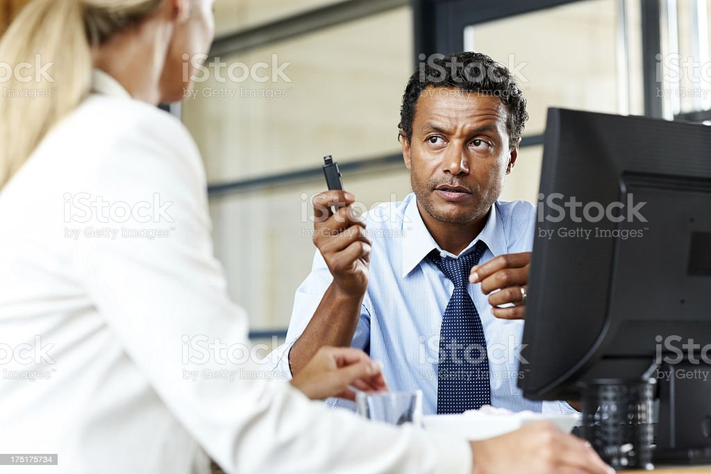Businesspeople sharing data in office stock photo