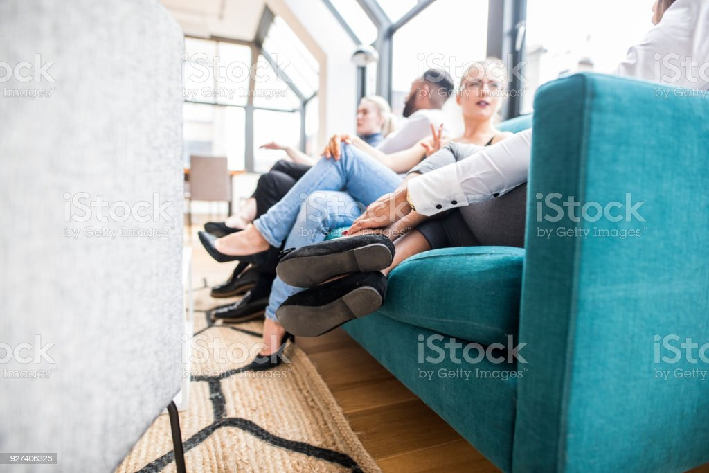 Businesspeople sitting and talking in the office stock photo