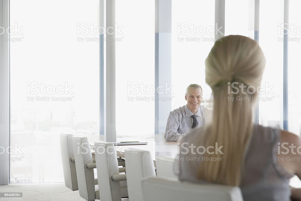 Businesspeople sitting at conference table royalty-free stock photo