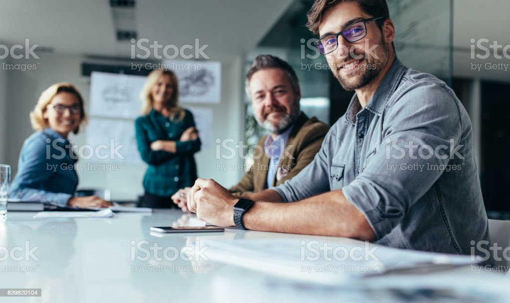 Businesspeople sitting in conference room stock photo