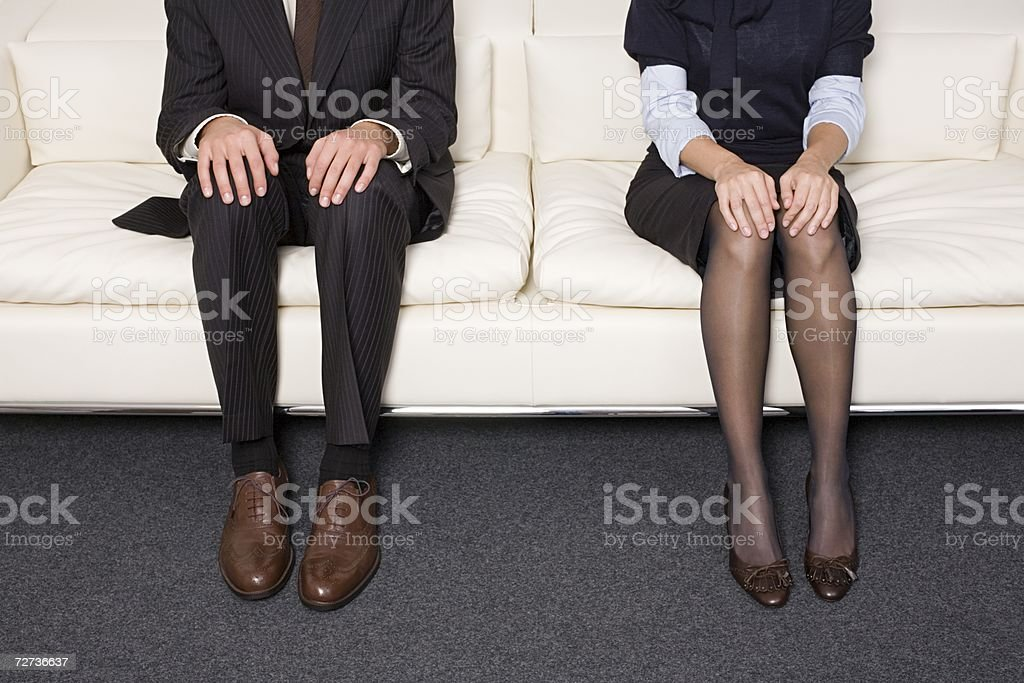 Businesspeople sitting next to each other royalty-free stock photo
