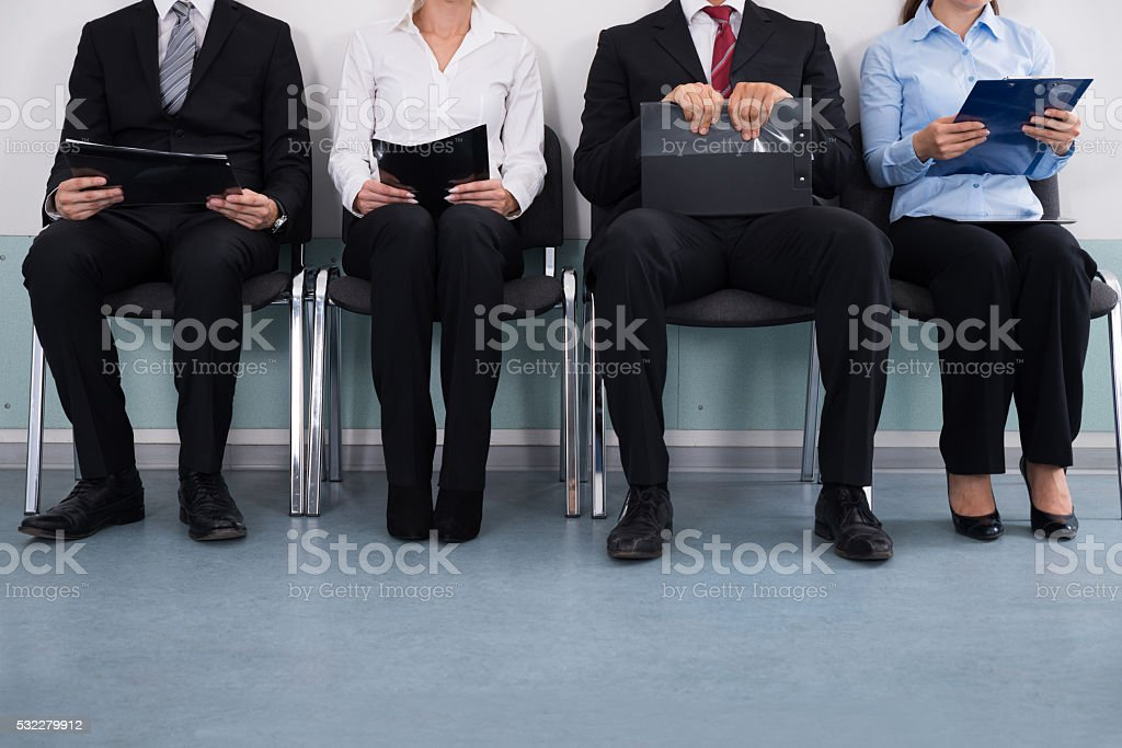 Businesspeople Sitting On Chair stock photo