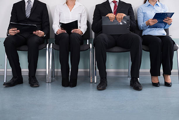 businesspeople sitting on chair - job search stock photos and pictures
