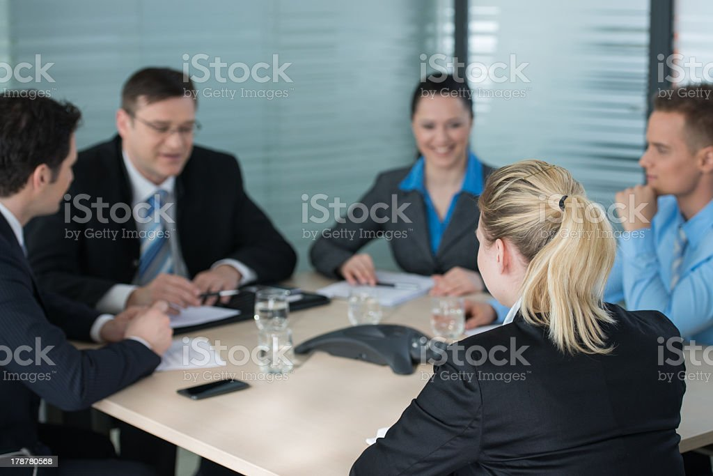 Businesspeople smiling at a teleconference stock photo
